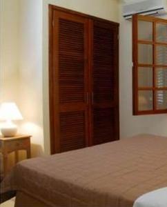 Cama ou camas em um quarto em Blue Bay village villa 11