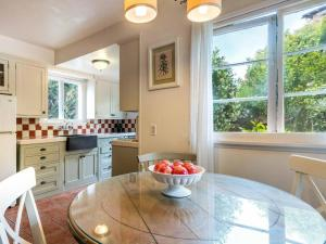 A kitchen or kitchenette at Redwood Hollow Cottages