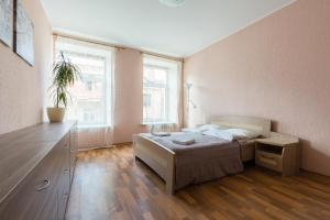 """Кровать или кровати в номере Квартира """"1912"""" на Малой Пушкарской"""