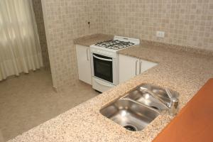 A kitchen or kitchenette at Inter Apart Hotel