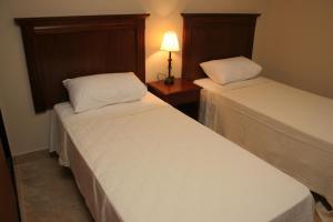 Una cama o camas en una habitación de Inter Apart Hotel
