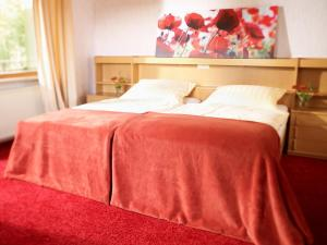 A bed or beds in a room at Berghotel Wintersberg
