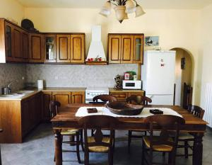A kitchen or kitchenette at Amarynthos Guest House