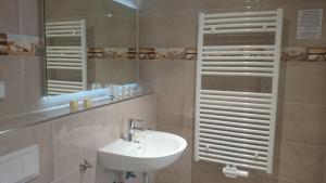 Ein Badezimmer in der Unterkunft Hotel Wald & Meer