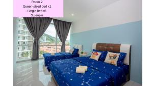 A bed or beds in a room at Sweet and Relaxing Homestay