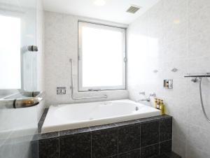 A bathroom at Wishton Hotel Yukari