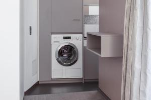 Ein Badezimmer in der Unterkunft EMA House Serviced Apartments Seefeld