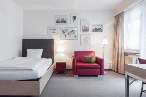 Ein Bett oder Betten in einem Zimmer der Unterkunft EMA House Serviced Apartments Seefeld