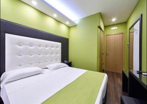 A bed or beds in a room at Reggia Suite Spa Hotel