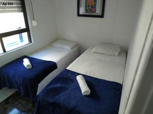 A bed or beds in a room at Goldani Lexus Plaza
