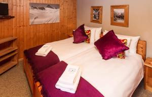 Ein Bett oder Betten in einem Zimmer der Unterkunft B&B de la Poste