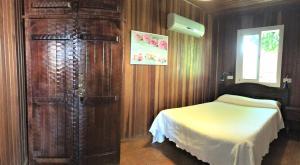 Cama o camas de una habitación en Casa Inmaculada Cabañas