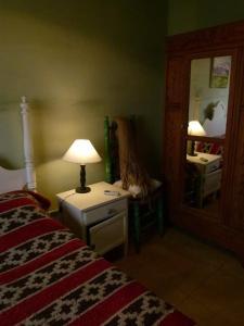 Una cama o camas en una habitación de La Rueca