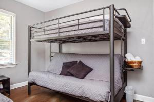 A bunk bed or bunk beds in a room at Great place for families in heart of hot Decatur!