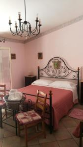 A bed or beds in a room at Cinisi 89 B&B