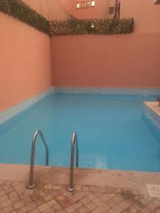 The swimming pool at or near At Home Marrakech with swimming pool