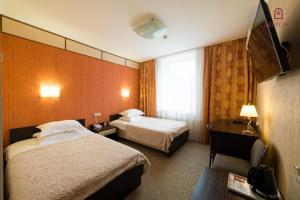 Кровать или кровати в номере Саппоро Отель