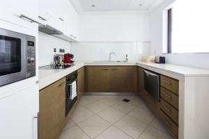 A kitchen or kitchenette at Frank Porter - Marsa Plaza