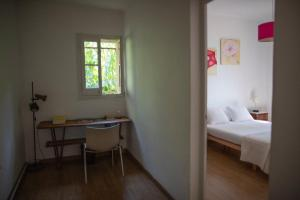 A bed or beds in a room at Beautiful Villa surrounded by nature in BCN