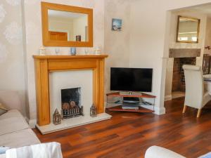 A television and/or entertainment center at Penrhyn View