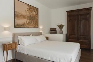 Letto o letti in una camera di Il Gallo Bianco