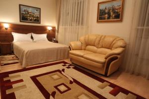 Кровать или кровати в номере Злата Прага