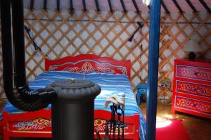 Un ou plusieurs lits dans un hébergement de l'établissement Maison Mariposa