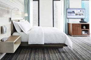 A bed or beds in a room at Park Terrace Hotel on Bryant Park