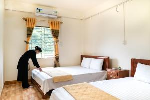 A bed or beds in a room at Minh Quang homestay