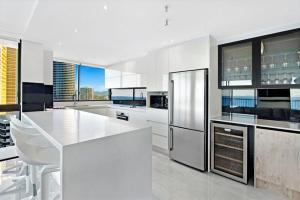 A kitchen or kitchenette at ULTIQA Beach Haven on Broadbeach