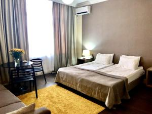 A bed or beds in a room at Boutique Hotel Amra