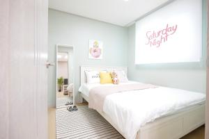 A bed or beds in a room at H House Yeonnam