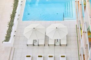 Uitzicht op het zwembad bij HM Dunas Blancas of in de buurt