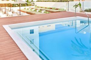 Het zwembad bij of vlak bij HM Dunas Blancas