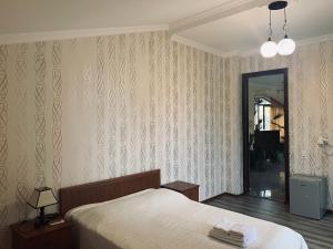 Ліжко або ліжка в номері Hotel Amigo I