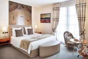Un ou plusieurs lits dans un hébergement de l'établissement Hotel & Spa REGENT PETITE FRANCE