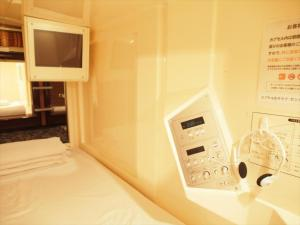 A television and/or entertainment center at Capsule Hotel Shibuya