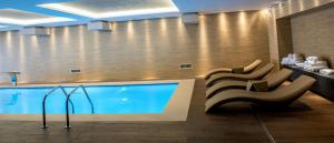 The swimming pool at or near Kronwell Brasov Hotel