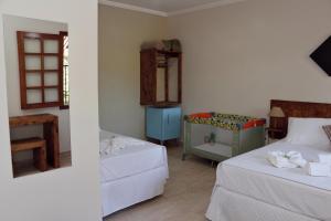 Cama ou camas em um quarto em Pousada Mirante Do Lago