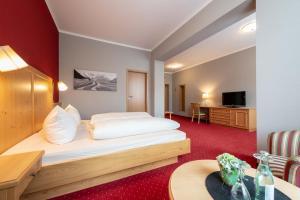Ein Bett oder Betten in einem Zimmer der Unterkunft Hotel Vollmann