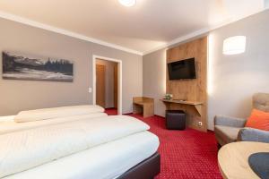 Ein Sitzbereich in der Unterkunft Hotel Vollmann