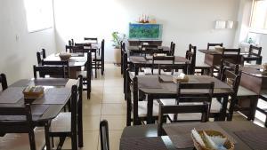Um restaurante ou outro lugar para comer em Golden Hotel