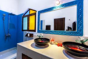 A bathroom at AHG Waridi Beach Resort & SPA