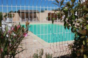 The swimming pool at or near Hôtel Le Manoir