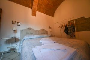 A bed or beds in a room at Il Sogno di Annalisa in Famiglia