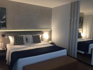 Cama ou camas em um quarto em Blue Tree Premium Faria Lima