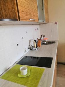 A kitchen or kitchenette at Студия в новом доме на 12 этаже