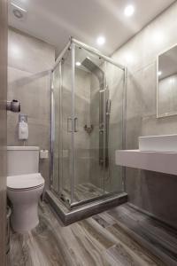 A bathroom at Kyma Rooms & Suites