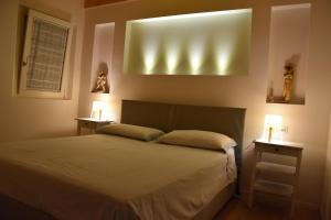 A bed or beds in a room at Suite In Centro Storico