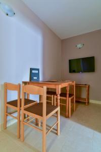 Телевизор и/или развлекательный центр в Apartments Srzentic